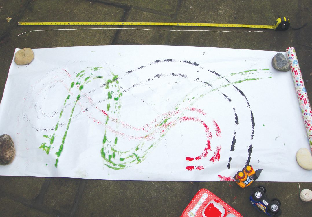 Roll out a large piece of paper on the floor and invite children to dip the wheels of toy vehicles in paint and roll them on the paper to make long wavy tracks
